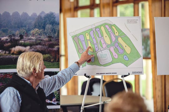 Piet Oudolf points to a master plan he's designed for a garden on Belle Isle.