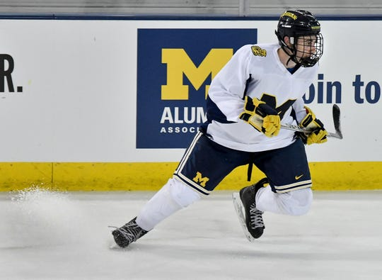 Quinn Hughes, a Hobey Baker candidate who just wrapped up his second season in Ann Arbor, signed a three-year entry-level contract with the Vancouver Canucks on Sunday.