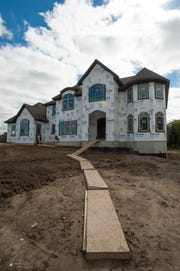 On-going construction of a luxury home at the David Campo Builders 'Casa Loma' development in Novi.