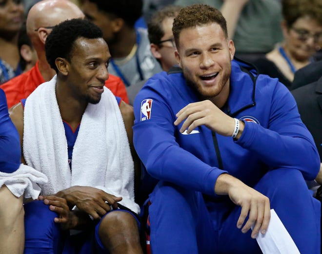 Detroit Pistons guard Ish Smith, left, and forward Blake Griffin, right.