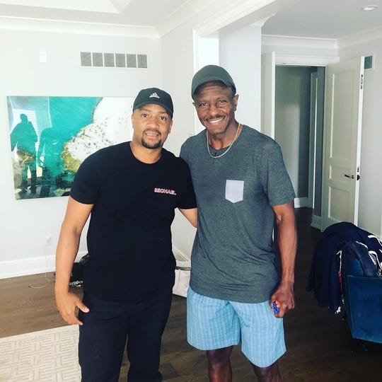 Michael Guyton, left, owner of Coming Attractions, with his client, Detroit Pistons head coach Dwane Casey.