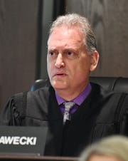 Judge Mark J. Plawecki oversees the arraignment of Westland Paramedics Leah Maynard, Matt Dicosola and Westland Police Sergeant Ronald Buckley at the 20th District Court in Dearborn Heights, Michigan on October 4.