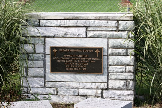This monument and plaque honoring Joe Brewer appears at Brewer Memorial Stadium at Elmira Notre Dame High School.