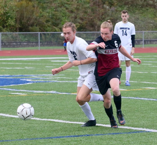 Quinn Diehl, left, of Binghamton and Griffen Squires of Elmira chase the ball Oct. 4, 2018 during Elmira's 4-1 win at Ernie Davis Academy.