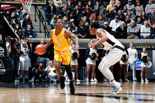 Dec 7, 2017; West Lafayette, IN, USA; Valparaiso Crusaders guard Bakari Evelyn (4) brings the ball up court against Purdue Boilermakers guard Nojel Eastern (20) during the second half at Mackey Arena.