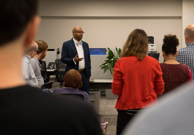 Michael McCarter introduces himself to the Courier & Press reporting staff Thursday morning. McCarter was named executive editor of the paper. He comes to Evansville after serving as the Cincinnati Enquirer's senior news director.