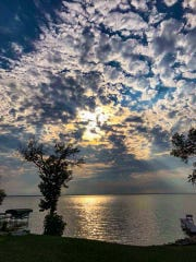 In early August, Paul Osterholm took this picture of the sunset after learning he and Nicole Braatz were a match. In it, they see an angel.