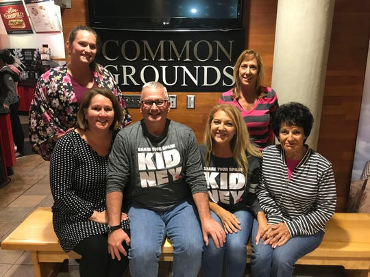 Since meeting, the Braatz and Osterholm families have become close. Pictured at Common Grounds are, front row from left: Janet Osterholm, Paul Osterholm, Nicole Braatz and Mary Braatz; back row, from left: Maggie Osterholm and Candy Braatz-Markert.