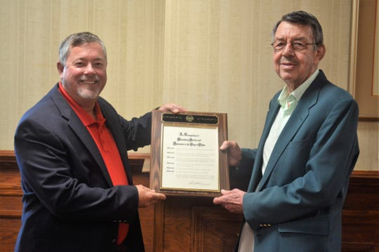 Clydescope board president Steve Spader, left, presents retired Clydescope director Jim Avery with a plaque recognizing the decades of service Avery gave to the community of Clyde.