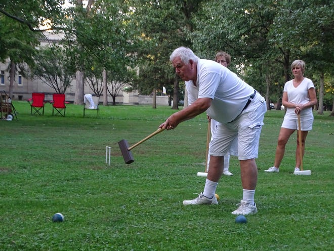 Dale Johnston of Fremont hits a shot Wednesday night at the Rutherford B. Hayes Presidential Library and Museums. Johnston is part of the Hayes Croquet Club that meets on Sundays and Wednesdays.