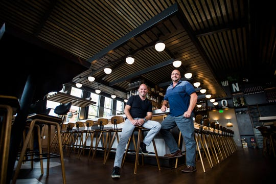 Old Town Restaurant Group co-owners Ryan Houdek, right, and Ty Fulcher pose for a portrait on Thursday, Oct. 4, 2018, at Union bar & soda fountain in Old Town Fort Collins, Colo.