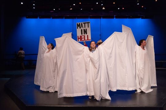 """A scene from """"The Laramie Project"""" depicts  Angel Action efforts to conceal people who demonstrated at Matthew Shepard's funeral. The Colorado State University School of Music Theatre and Dance recently performed """"The Laramie Project,"""" written by Moisés Kaufman and guest directed by Charlie Oates."""