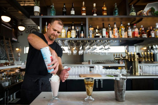 Union bar & soda fountain bartender Dave Bruning finishes making a strawberry shake on Thursday, Oct. 4, 2018, at Union bar & soda fountain in Old Town Fort Collins, Colo.