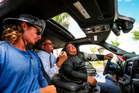 """Anthony Doublé helps get Chuck Cordisco familiar with his new truck. The new Cape Coral Chrysler Dodge Jeep Ram dealership has opened. The first sale went to Chuck Cordisco, a friend of the dealership general manager Jay Ganzi, who purchased a new, red Dodge Ram 2500 """"Power Wagon"""" 4 x 4."""