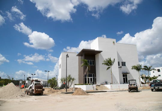 Work is being completed on the clubhouse at Amavida in south Fort Myers. Behind it is one of three pools and tennis courts.