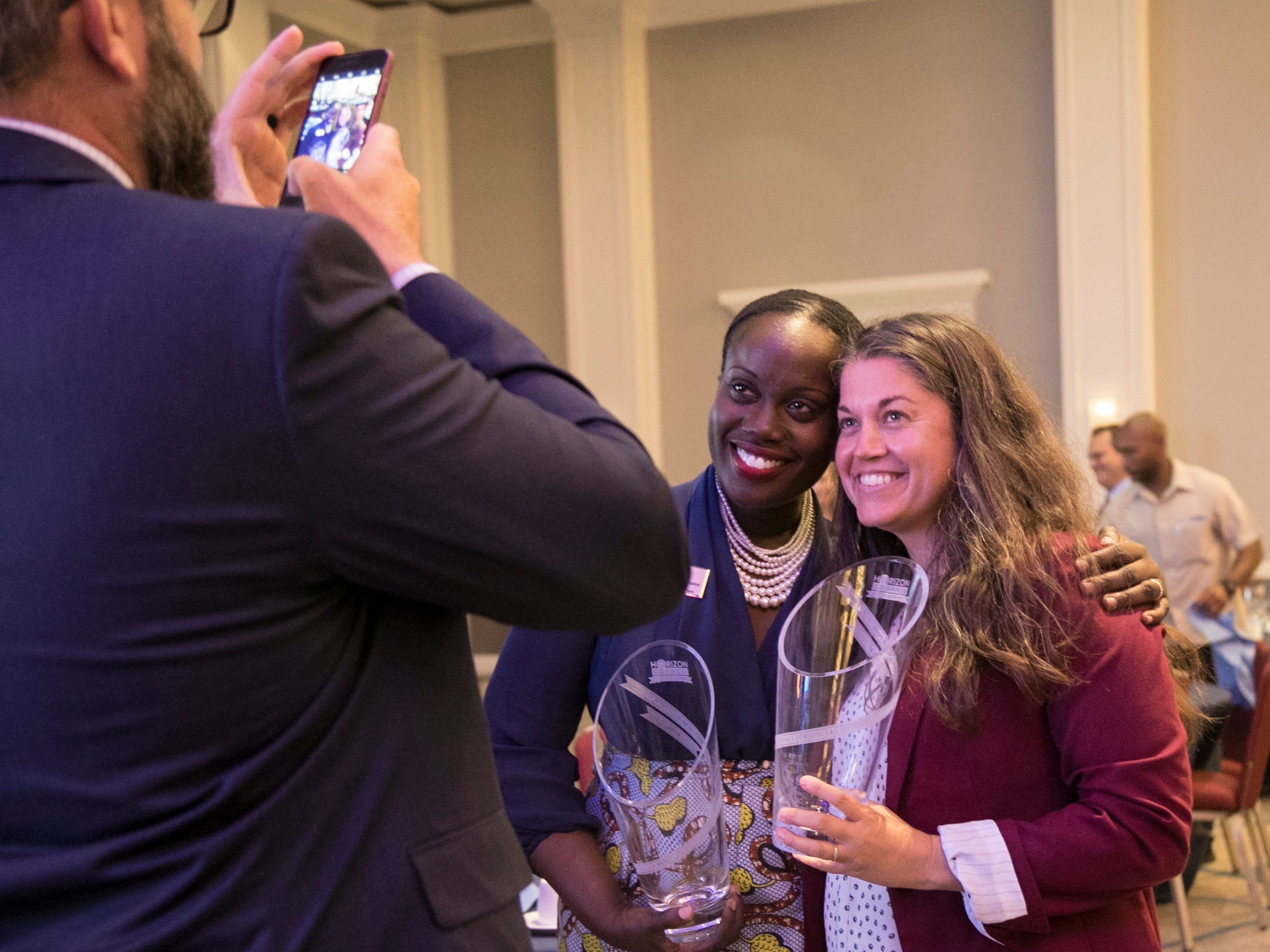Yemisi Oloruntola-Coates, of Lee Health, left,  and Lydia Black, of the Alliance for the Arts, get a photo together after the 2018 Industry Appreciation Awards on Thursday at the Hyatt Regency Coconut Point Resort and Spa in Bonita Springs. Lee Health won the Diversity in Business Award, and the Alliance for the Arts won Nonprofit of the Year for the small category.