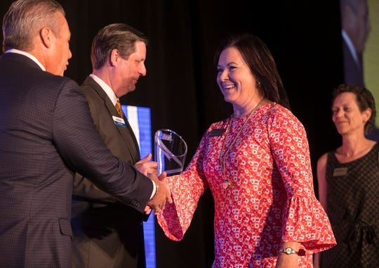 Kathryn Kelly, of the Heights Foundation, accepts the award for Nonprofit of the Year, large category during the 2018 Industry Appreciation Awards on Thursday at the Hyatt Regency Coconut Point Resort and Spa in Bonita Springs.