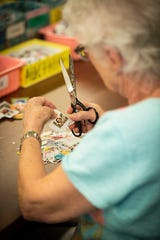 Many volunteers come in the stamp room two or three times a week where they gather with friends.