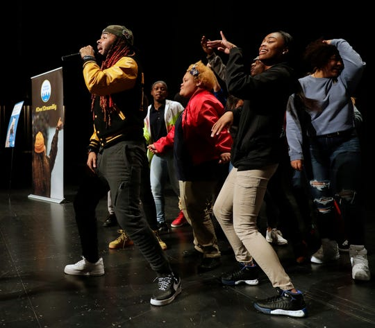 "Dee-1 performs his song ""Sallie Mae Back"" with high school students from northeastern Wisconsin dancing on stage on Sept. 26 at the Weidner Center in Green Bay."