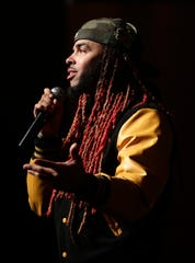 Dee-1, a Louisiana native who raps about college loan debt, speaks to high school students from northeastern Wisconsin on Sept. 26 at the Weidner Center in Green Bay.