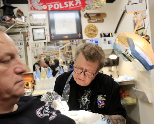 Rick Harnowski works on a tattoo on Kevin Casey of De Pere in his shop, Tattoos by Rick. Harnowski has been tattooing for 50 years in Green Bay. A retrospective exhibit of his art opens Monday at St. Norbert College.