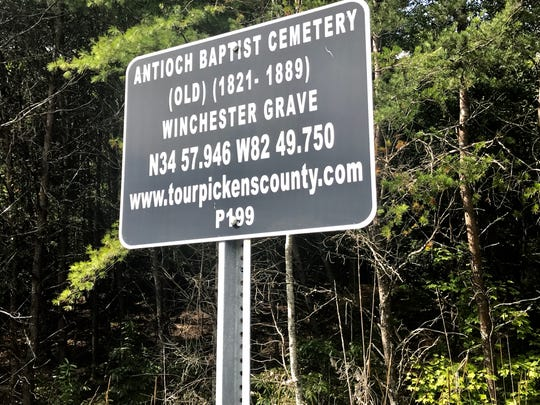 A sign on Scenic Highway 11 marks the location of the Winchester family cemetery.