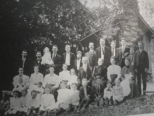 The Winchester family pose in this historical photo in front of the ancestral home place in Pickens County.