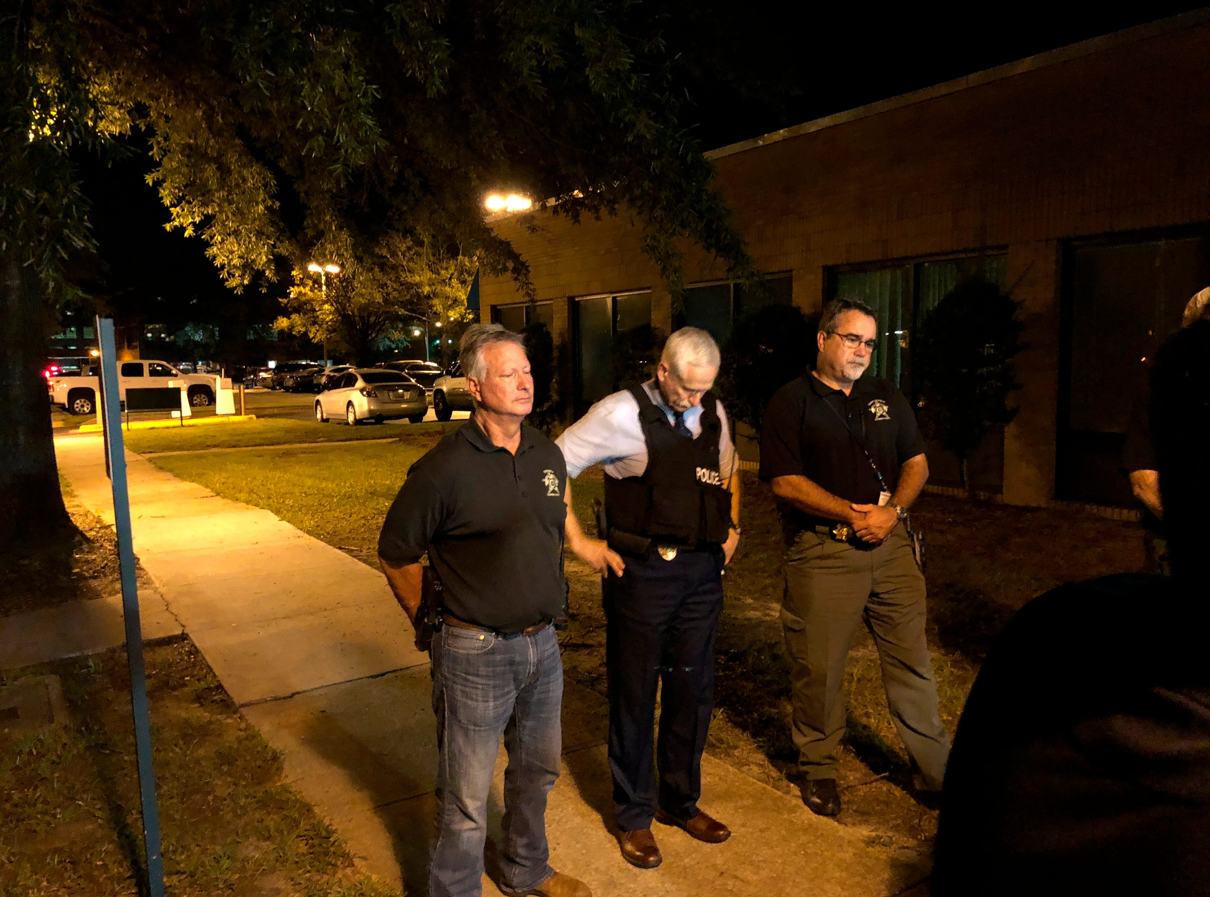 Florence County Sheriff Kenney Boone, from left, Florence Police Chief Allen Heidler and Florence County Chief Deputy Glenn Kirby speak to the media following a shooting where several law enforcement officers were shot, one fatally, Wednesday, Oct. 3, 2018, in Florence, S.C. (AP Photo/Jeffrey Collins)