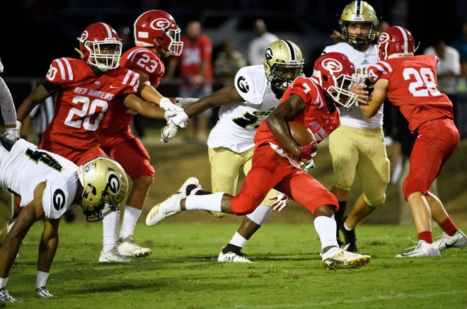 Sophomore wide receiver Aziz Huff (7) and the Greenville Red Raiders will travel to Blue Ridge Friday.