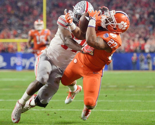 Clemson running back C.J. Fuller (27) catches a touchdown pass while defended by Ohio State linebacker Jerome Baker during the Fiesta Bowl in 2016.