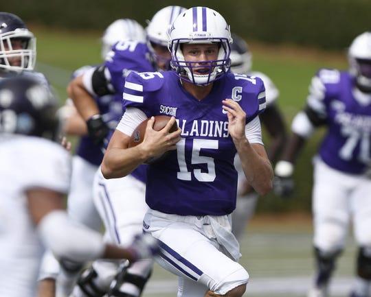 Furman quarterback Harris Roberts (15) reels off a huge gain against Western Carolina.