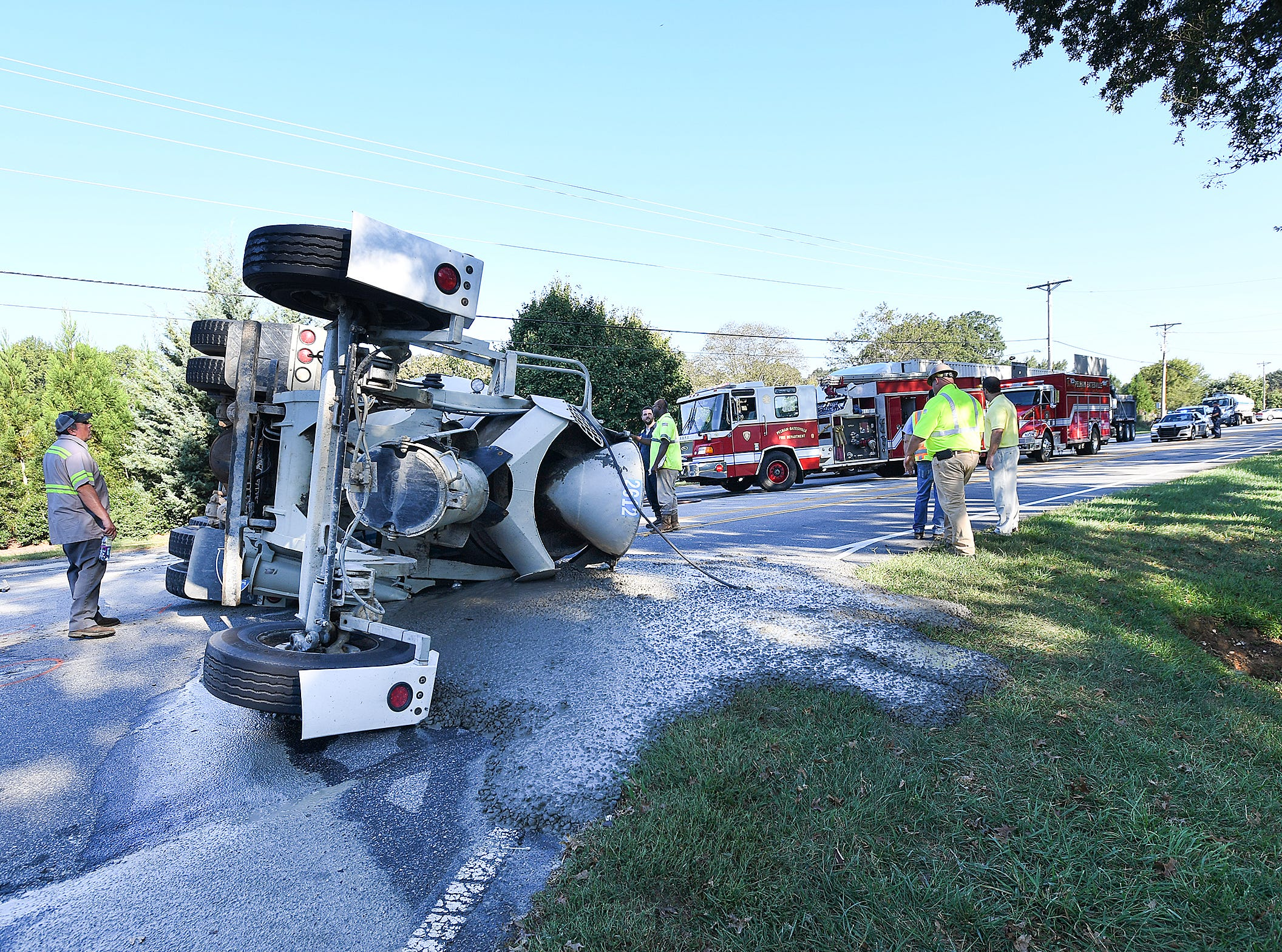 A cement truck overturned on South Carolina 14 at the entrance of Spalding Farm subdivision between Woodruff Road and and Interstate 85 on Thursday, Oct. 4, 2018.