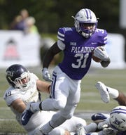Furman tailback Corey Watkins (31) rushed seven times for 41 yards against Georgia State in his first appearance of 2019.