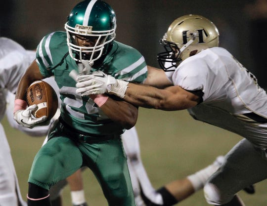 Easley's CJ Fuller tries to break the tackle of T.L. Hanna's Ben Boulware.