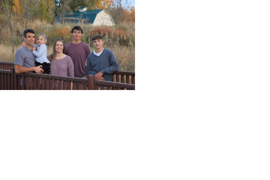 The family of Davis and Lisa Almanza includes sons Blake, far right, Jace, and daughter Adeline.
