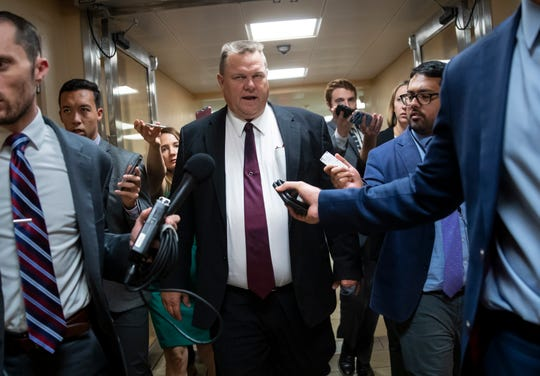 FILE--In this Sept. 18, 2018, file photo, Sen. Jon Tester, D-Mont., responds to reporters' questions on Supreme Court nominee Brett Kavanaugh on Capitol Hill in Washington, D.C. Tester's Republican opponent, Matt Rosendale, is accusing Tester, of obstructing the confirmation process of Kavanaugh. (Rachel Leathe/Bozeman Daily Chronicle via AP, FILE)