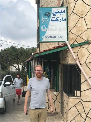 Sam Sweeney of Belt pauses at the Montana Mini Market (that's what it says in Arabic) in Akkar, Lebanon.