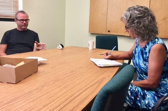 Kathleen Williams takes notes during her visit with Michael Kavanaugh, director at McLaughlin Research Institute.