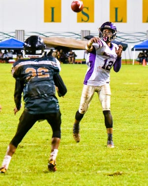 George Washington Geckos Aaron Jamanila tosses a touchdown pass to his cousin, D.J. Jamanila, in a game against the John F. Kennedy Islanders Sept. 21 at Ramsey Field in Tamuning. The versatile Aaron Jamanila is the PDN's Player of the Week.