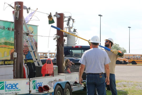 A demonstration is given to students about power lines.