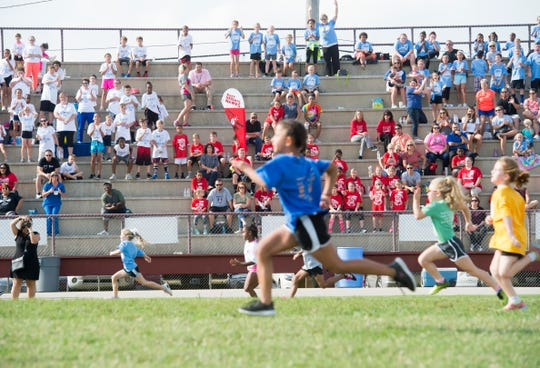 Students fill the stands and cheer on their teammates during the 77th Annual Archie Riehl Rotary Field Day at North Middle Thursday, Oct. 4, 2018.