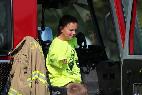 Drew Gatten takes part in safety day by taking a seat in the fire truck.