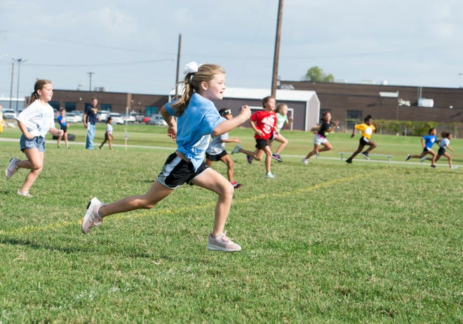 Pacey Parker, 2nd grader at A.B. Chandler Elementary, runs the 40-yard dash during the 77th Annual Archie Riehl Rotary Field Day at North Middle school Thursday, Oct. 4, 2018.
