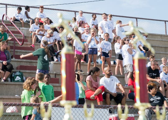 Bend Gate Elementary school students cheer on their teammates from the stand during the 77th Annual Archie Riehl Rotary Field Day at North Middle Thursday, Oct. 4, 2018.