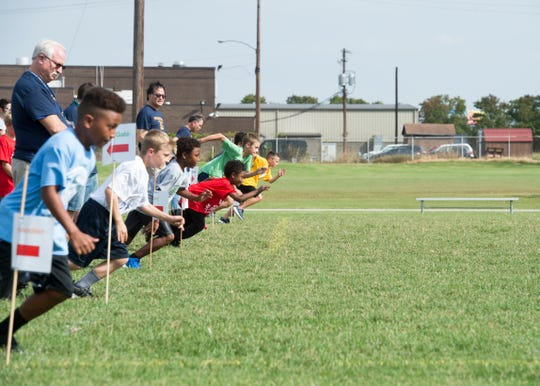 Boys from local elementary school compete in the 60-yard dash during the during the 77th Annual Archie Riehl Rotary Field Day at North Middle Thursday, Oct. 4, 2018.