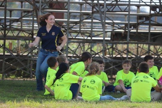 """FFA Student Mallory White plays """"Duck, Duck, Goose"""" with her group of 5th graders during a break at Safety Day."""