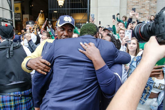 Dexter Williams embraces his parents Leonard and Cheryl during Notre Dame's pregame walk prior to the Stanford game.