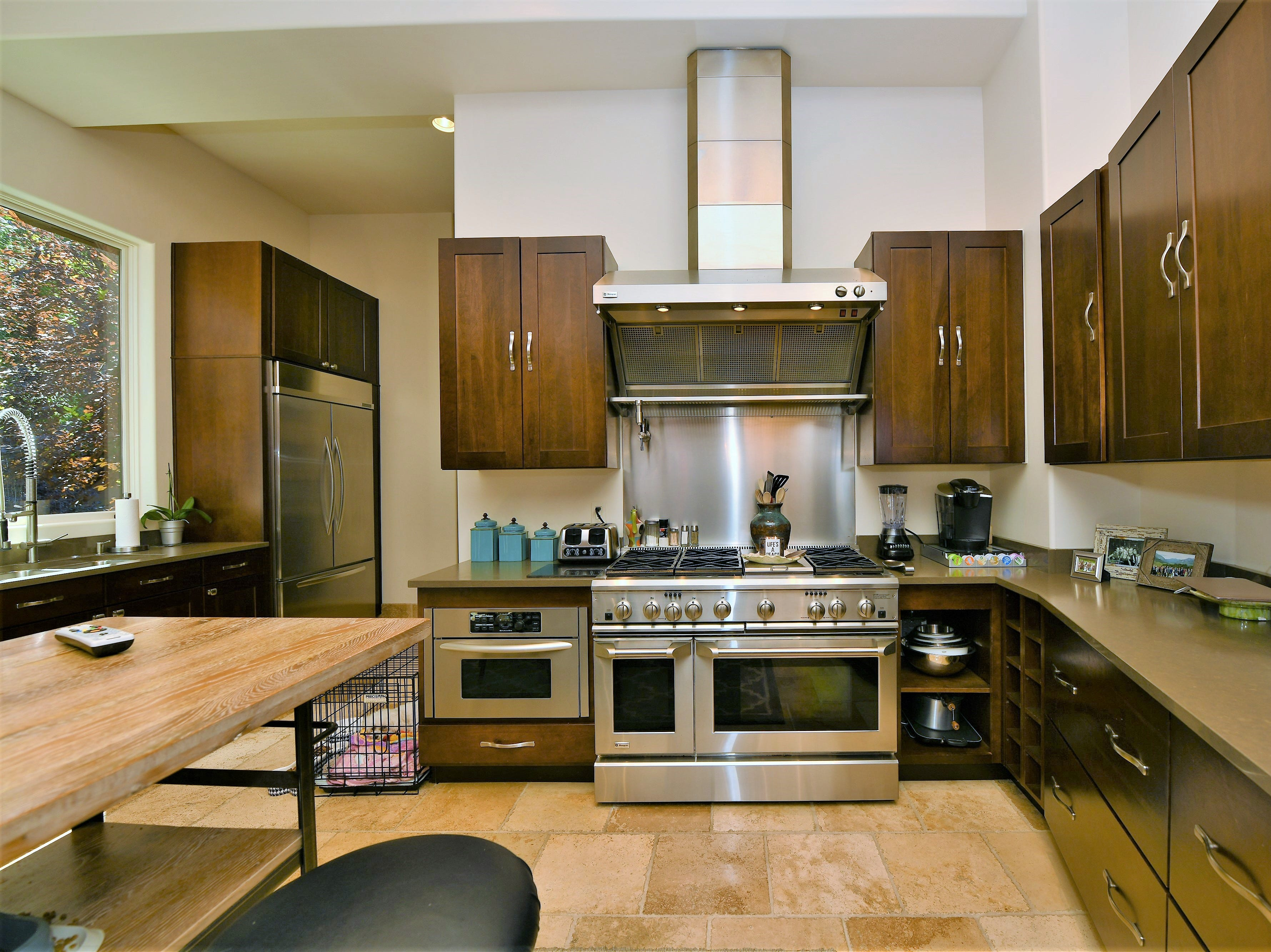 """Behind the main kitchen is a pantry and second """"preparatory"""" kitchen with laundry, which is often used when catering events at the house."""