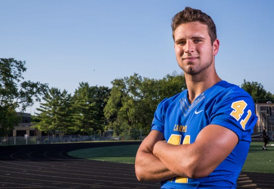 Carmel defensive end Beau Robbins will have his hands full against Warren Central on Friday.