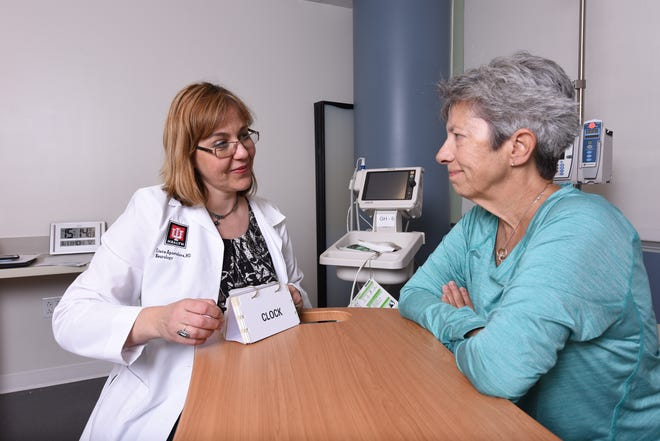 Dr. Liana Apostolova, an IU School of Medicine neurologist, meets with a patient.